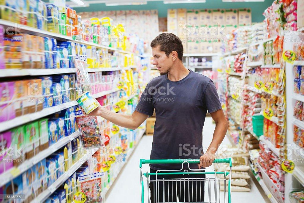 man in supermarket stock photo