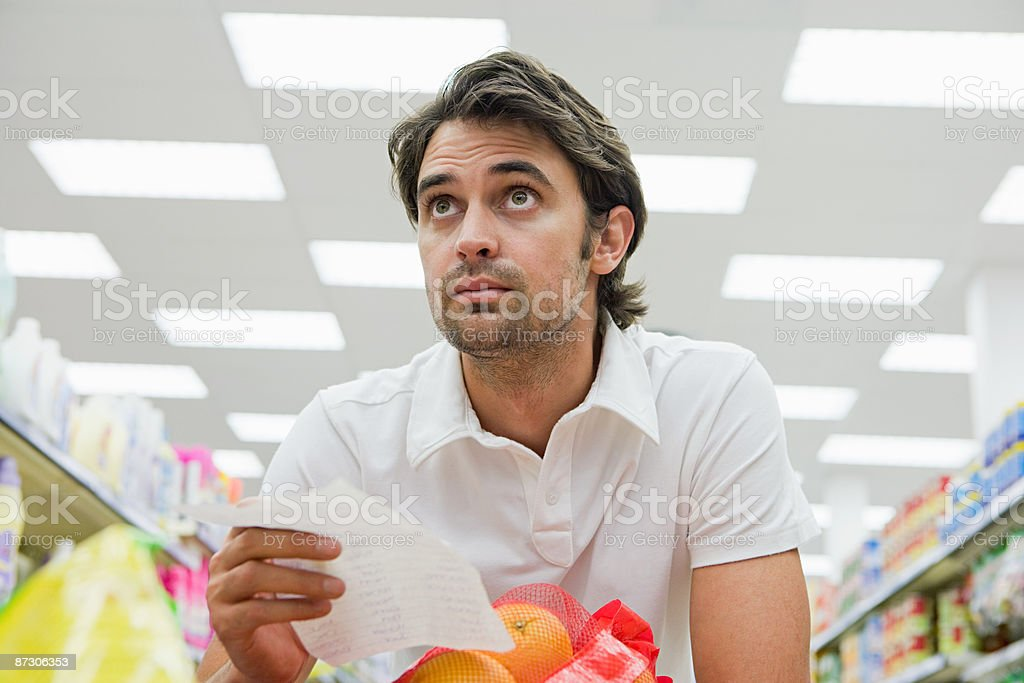 Man in supermarket royalty-free stock photo