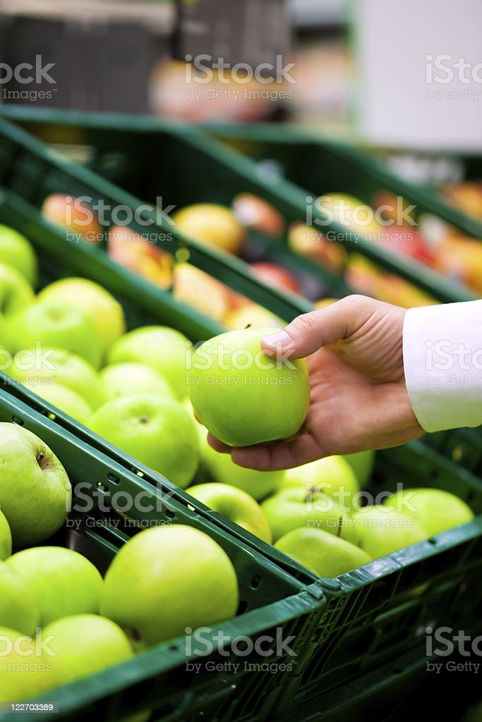 Man in supermarket shopping groceries royalty-free stock photo