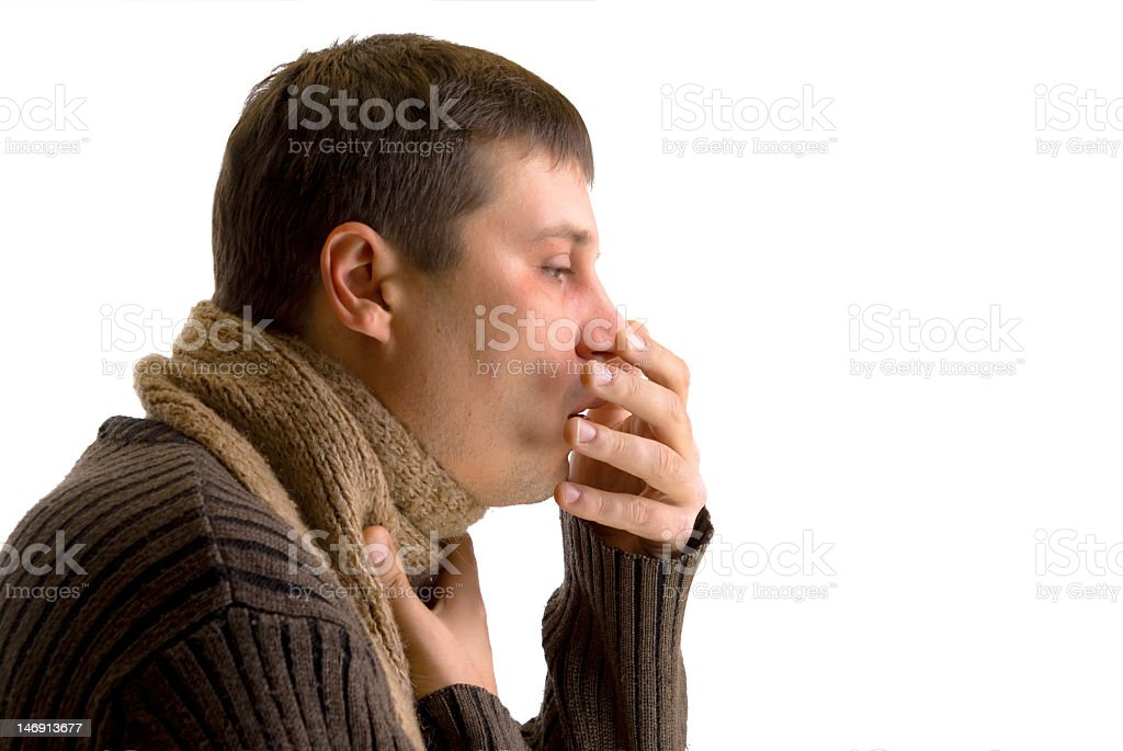 Man in sweater and scarf coughing while covering mouth royalty-free stock photo