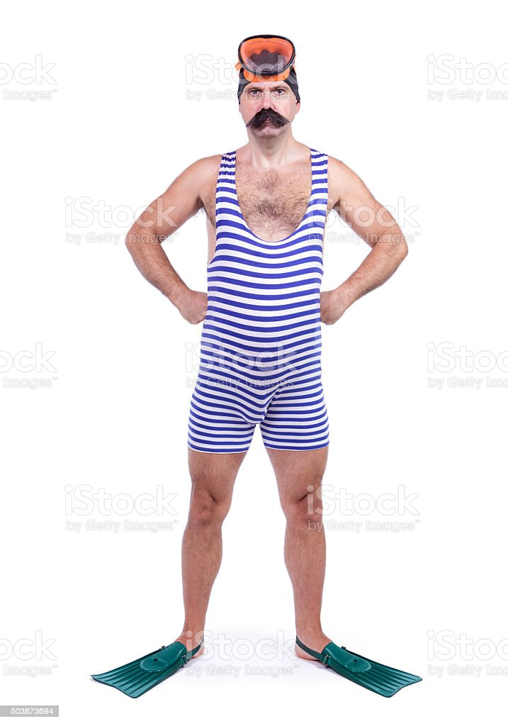 Man in swim dress standing with hands on hips stock photo