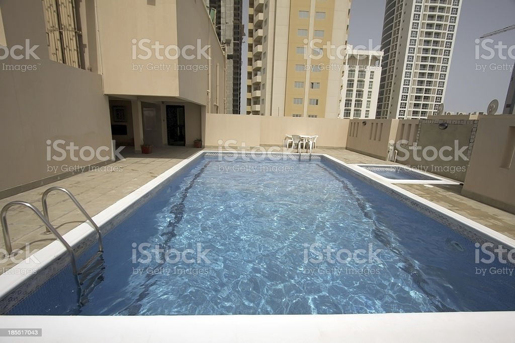 man in swimming pool at roof royalty-free stock photo