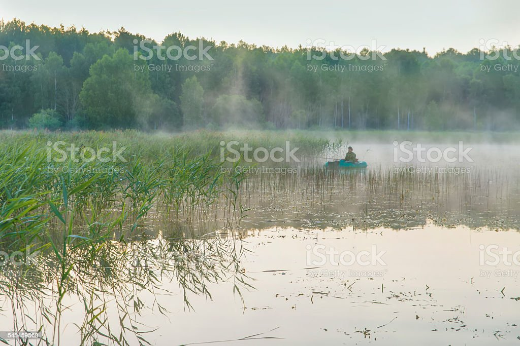man in the boat stock photo