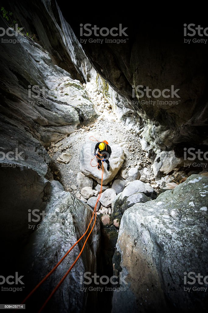 Man in the cave stock photo