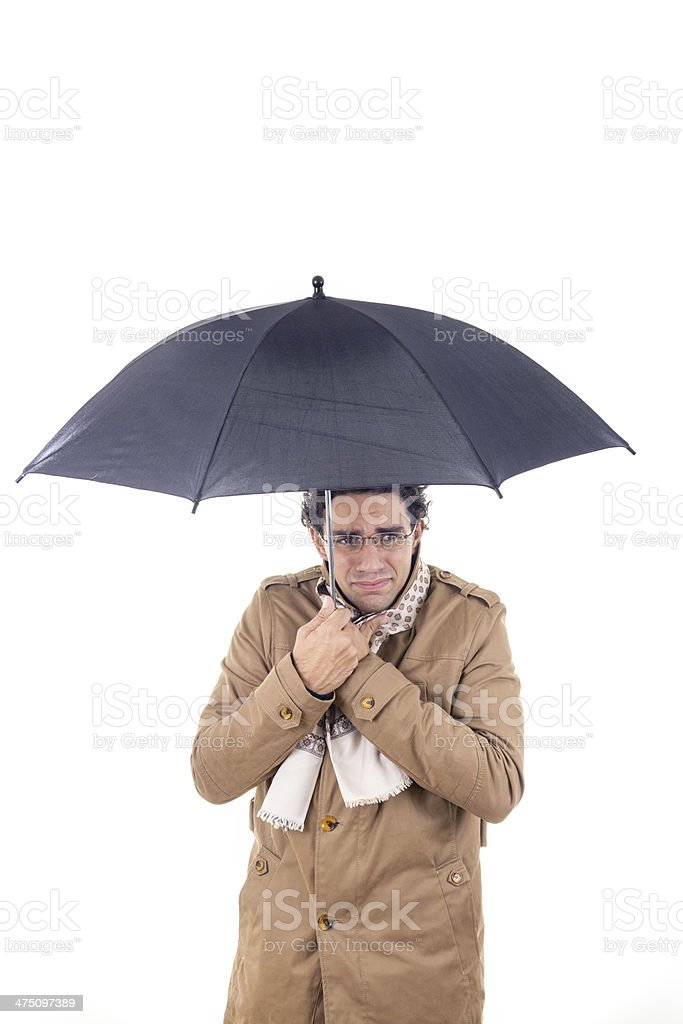 man in the coat with umbrella freezes royalty-free stock photo