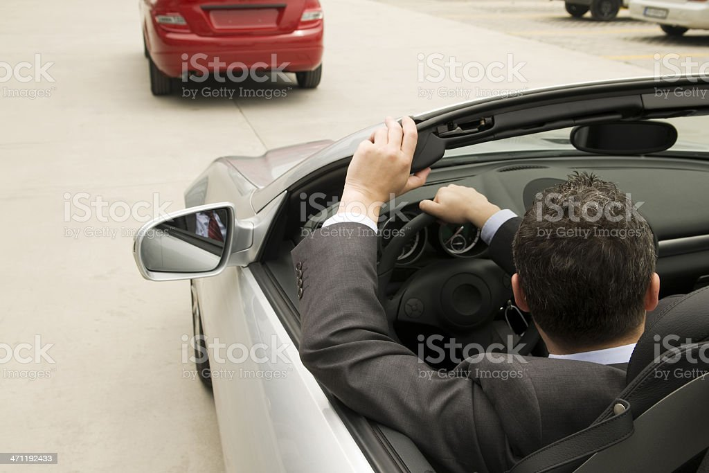 Man in the convertible stock photo