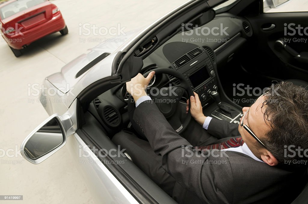 Man in the convertible royalty-free stock photo
