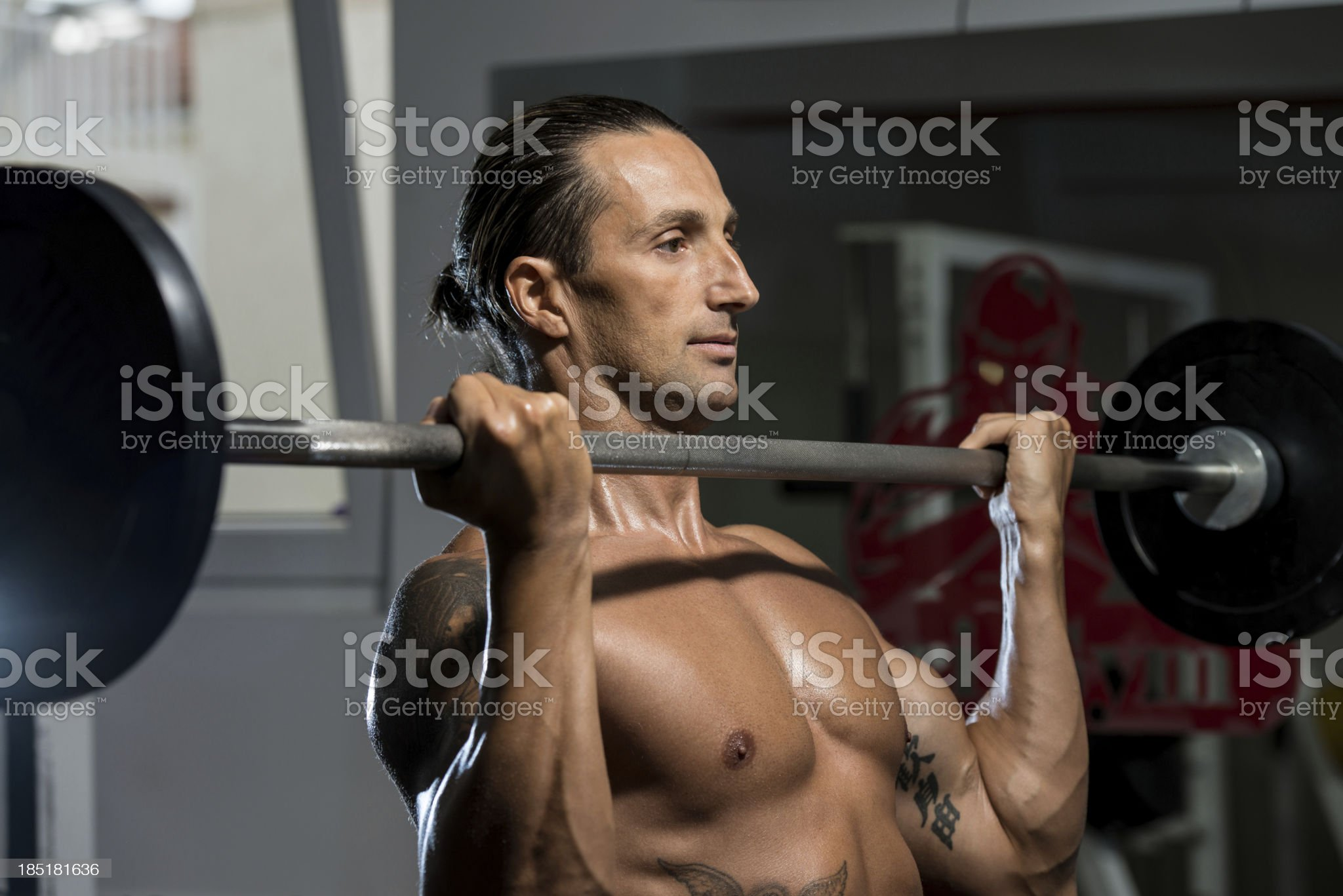 Man In The Gym Exercising Biceps With Barbell royalty-free stock photo