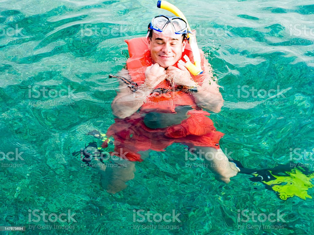 Man in the life vest enjoing ocean royalty-free stock photo