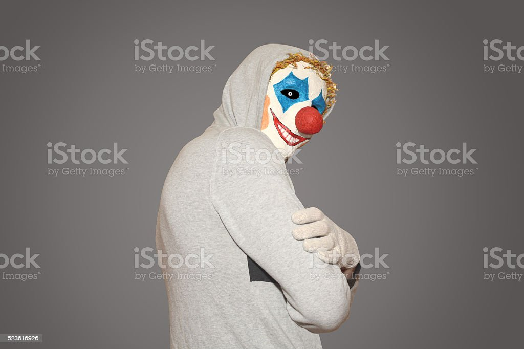 Man in the mask evil clown stock photo