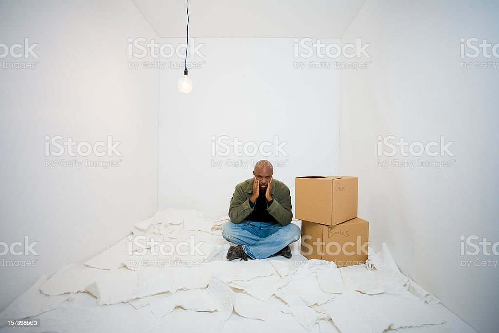 Man in the middle of packing loses focus royalty-free stock photo