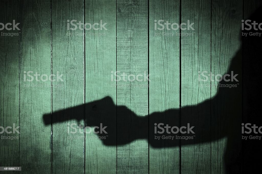 Man in the Shadows with handgun, XXXL stock photo