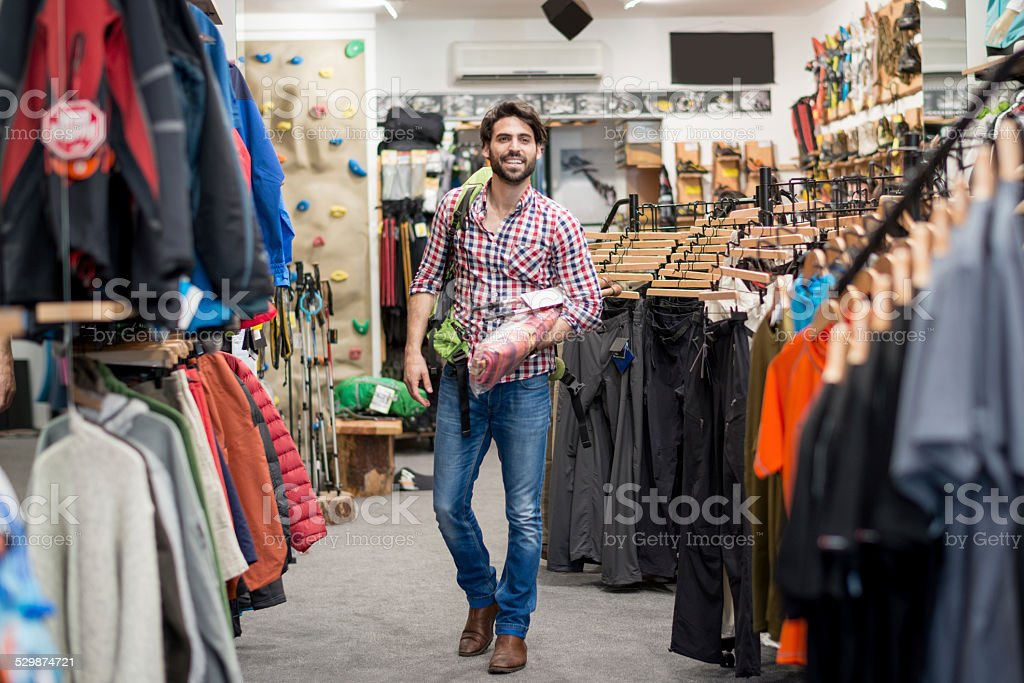Man in the store buying outdoor equipment stock photo