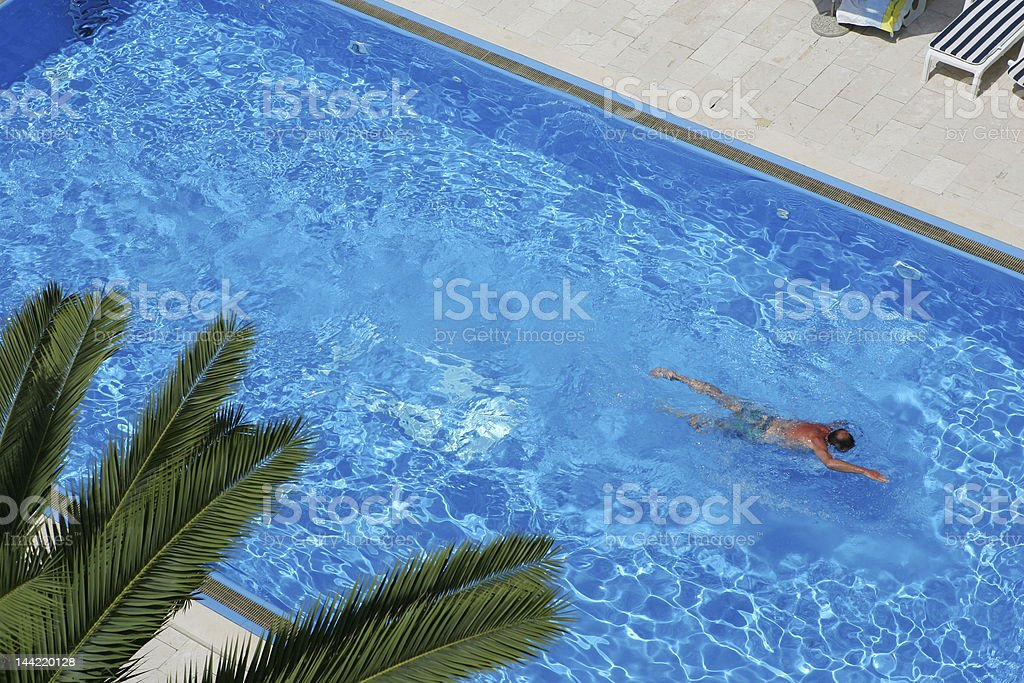 Man in the swimming pool royalty-free stock photo