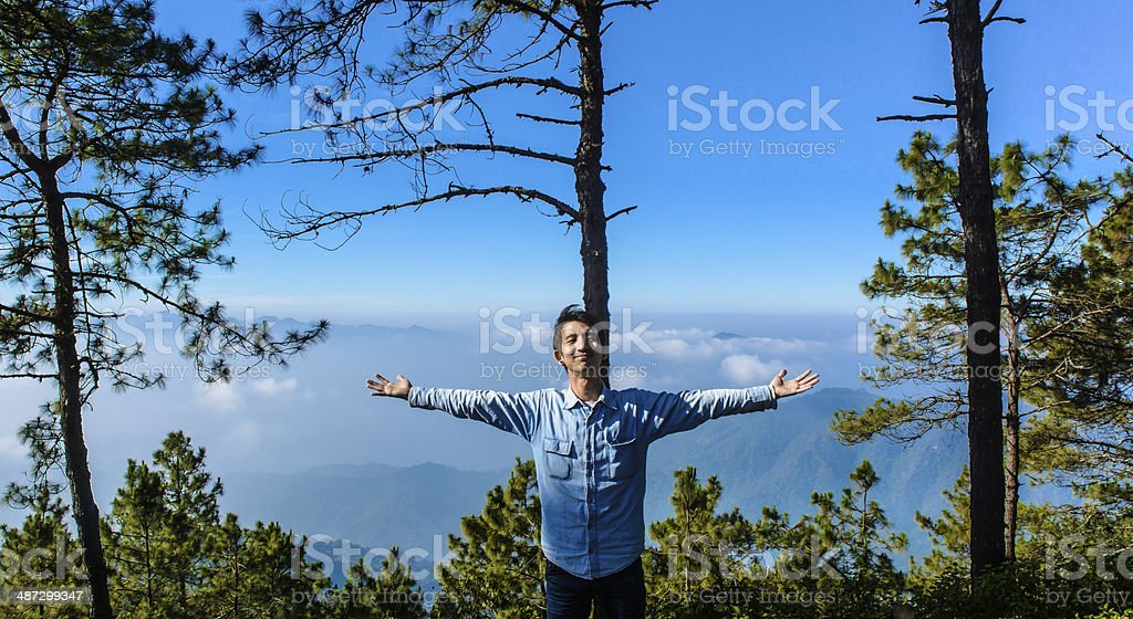 man in the winter mountains stock photo
