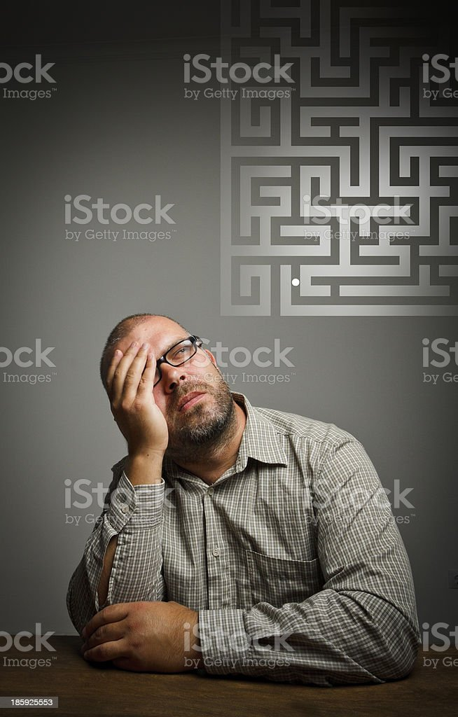 Man in thoughts. Dreamer and maze. royalty-free stock photo