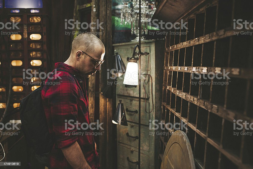 Man in thrift shop - second hand store stock photo