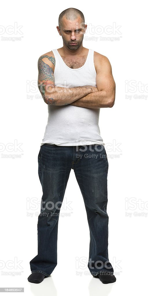 Man in Tough Guy Pose With Arms Crossed stock photo
