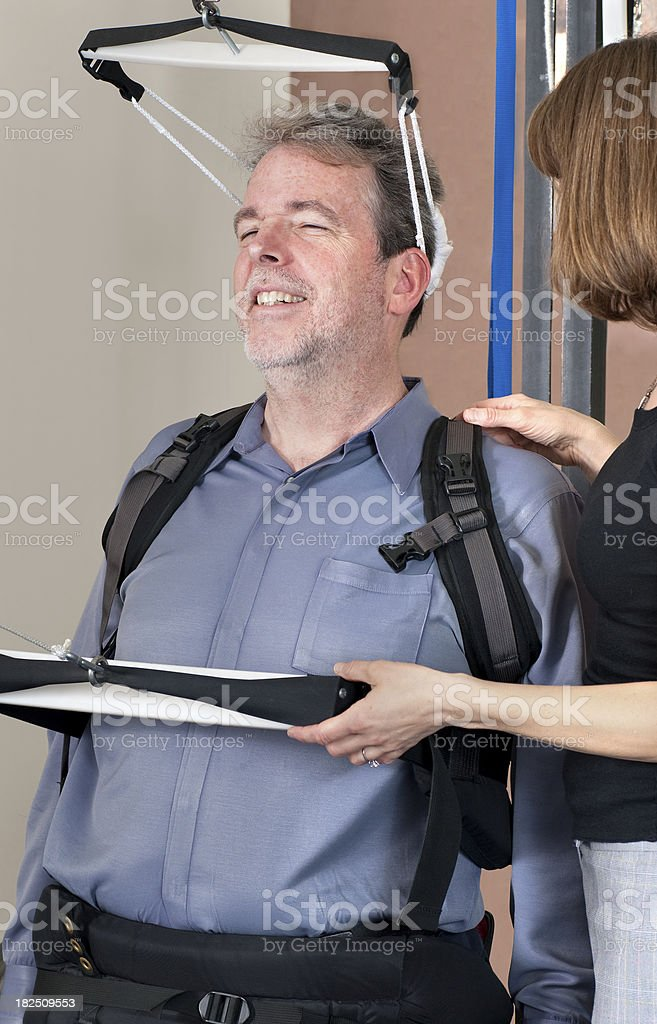 Man in Traction - Chiropractor Series stock photo