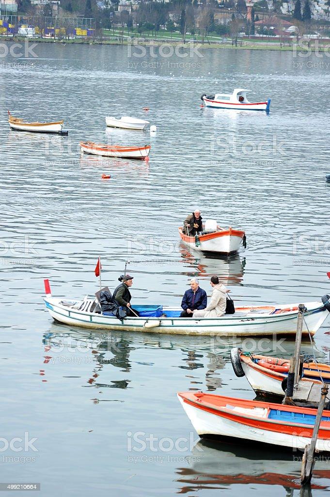 Man in tradicional boat stock photo