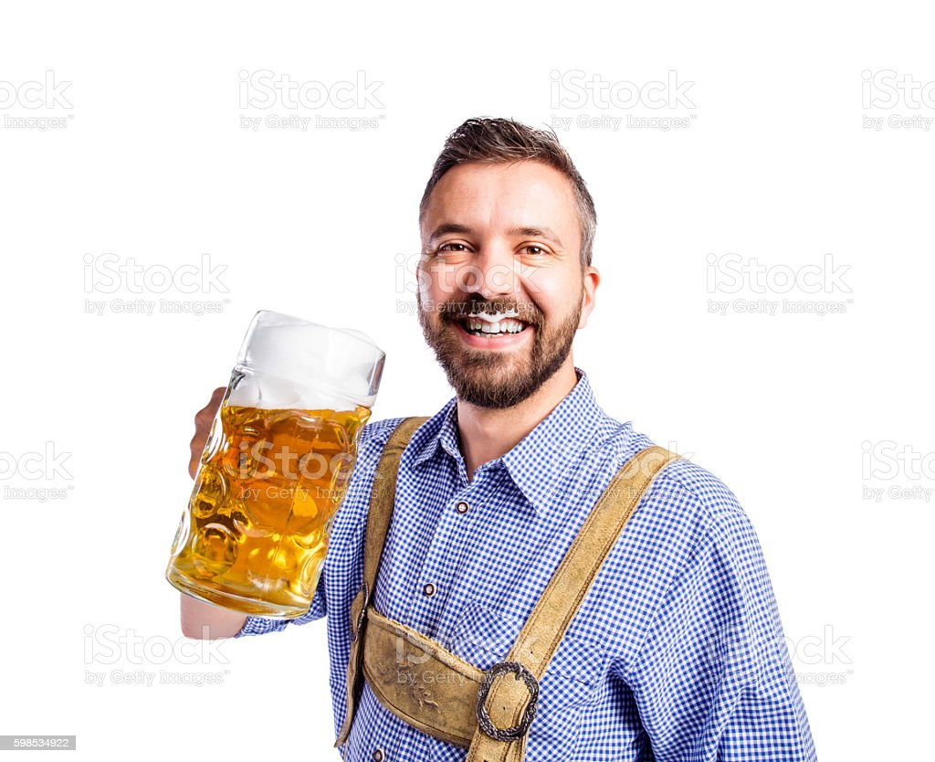 Man in traditional bavarian clothes drinking beer stock photo