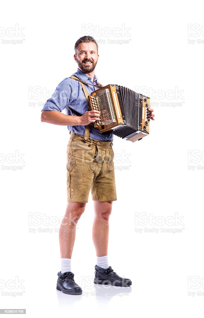 Man in traditional bavarian clothes playing accordion. Oktoberfe stock photo