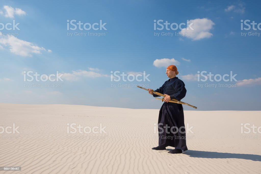 Man in traditional clothes is practicing martial arts stock photo
