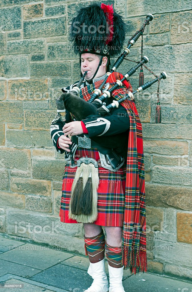 Man in traditional Scottish dress playing bagpipes in Edinburgh stock photo