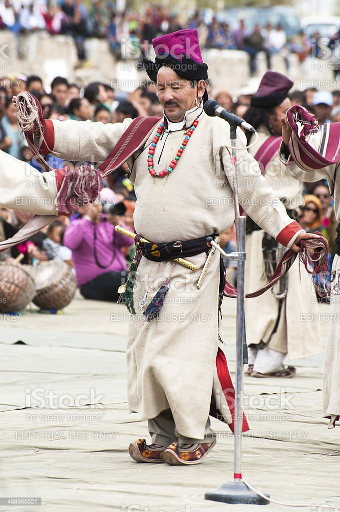 Man in traditional Tibetan clothes performing folk dance royalty-free stock photo