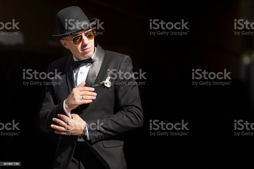 Man in tuxedo and hat stock photo