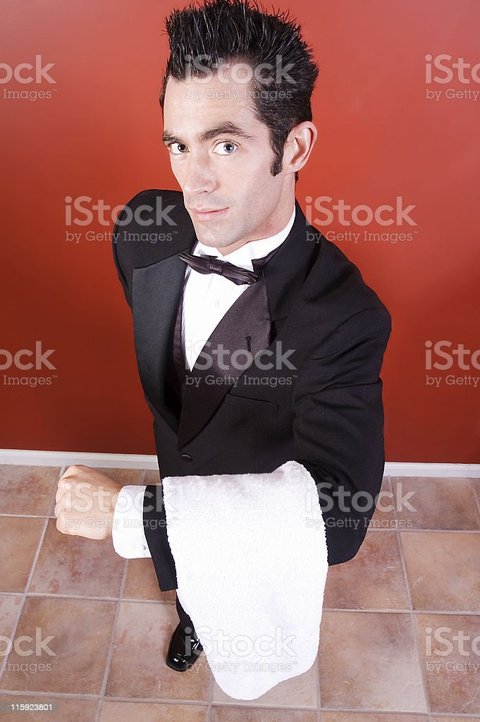 Man in tuxedo offering service royalty-free stock photo