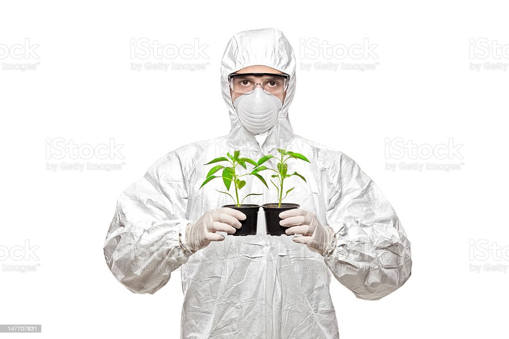 Man in uniform holding plants royalty-free stock photo