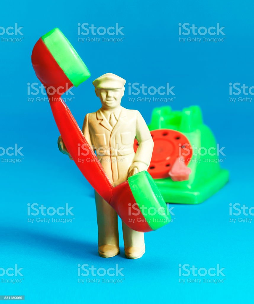 Man in Uniform Holding Telephone stock photo