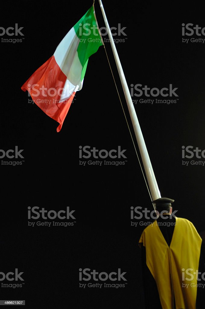 Man in uniform raising the Italian flag, back view royalty-free stock photo