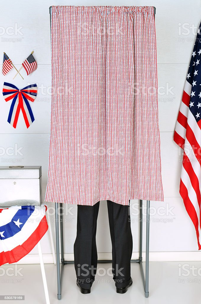 Man in Voting Booth stock photo