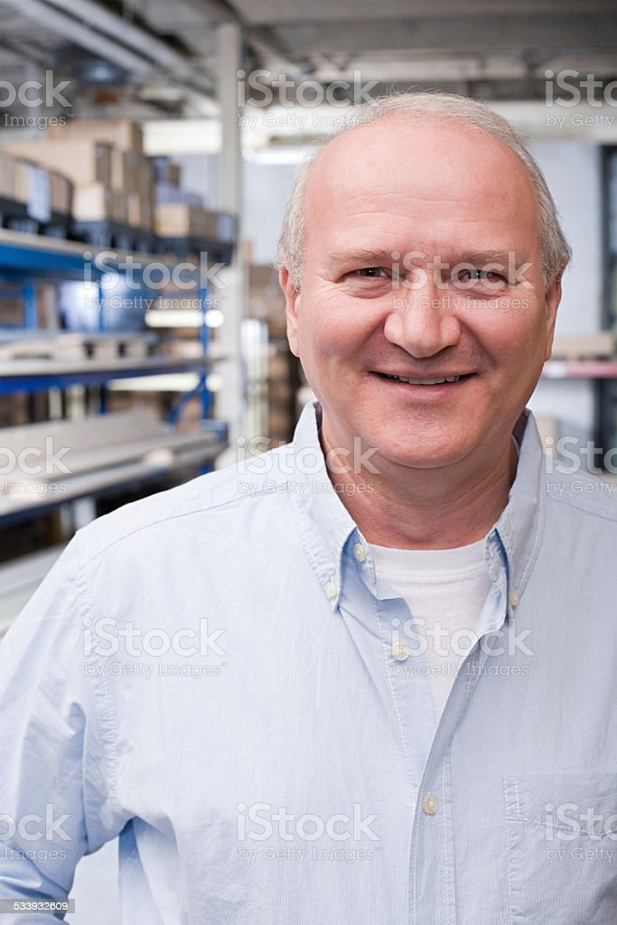 Man in warehouse stock photo