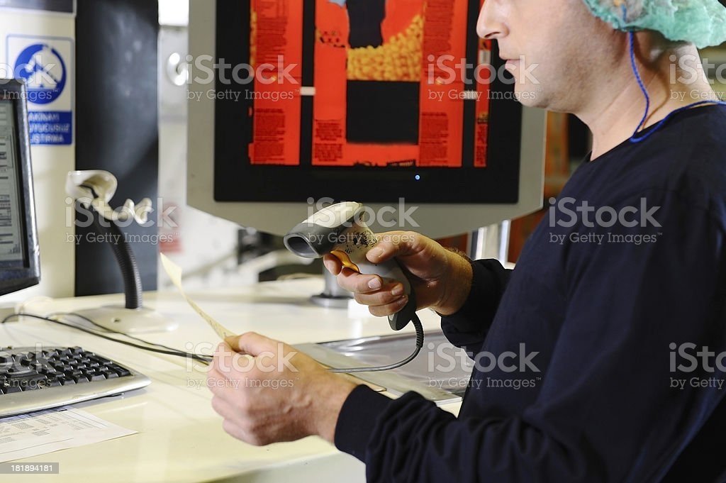 Man in warehouse uses barcode reader royalty-free stock photo