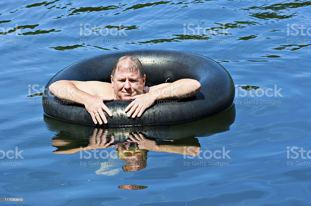 Man in Water with Tube royalty-free stock photo