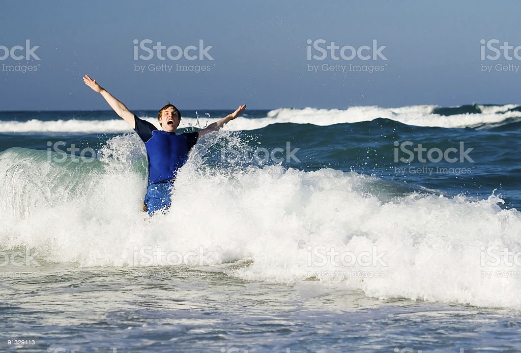 Man in waves royalty-free stock photo