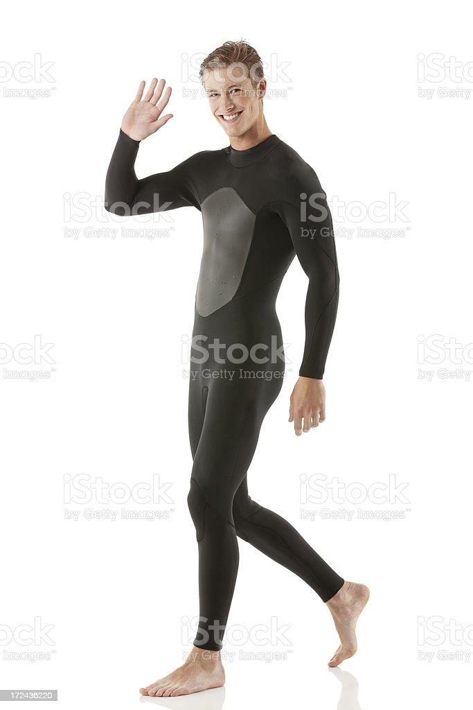 Man in wet suit waving hand royalty-free stock photo