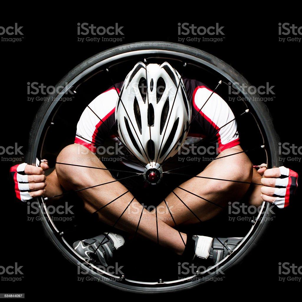 Man In Wheel stock photo
