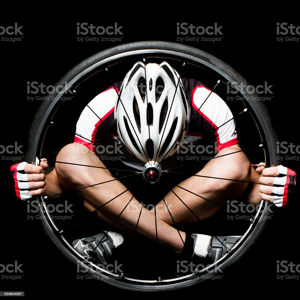 Man In Wheel stock photo