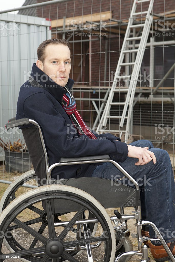 Man in wheelchair after accident at work. stock photo