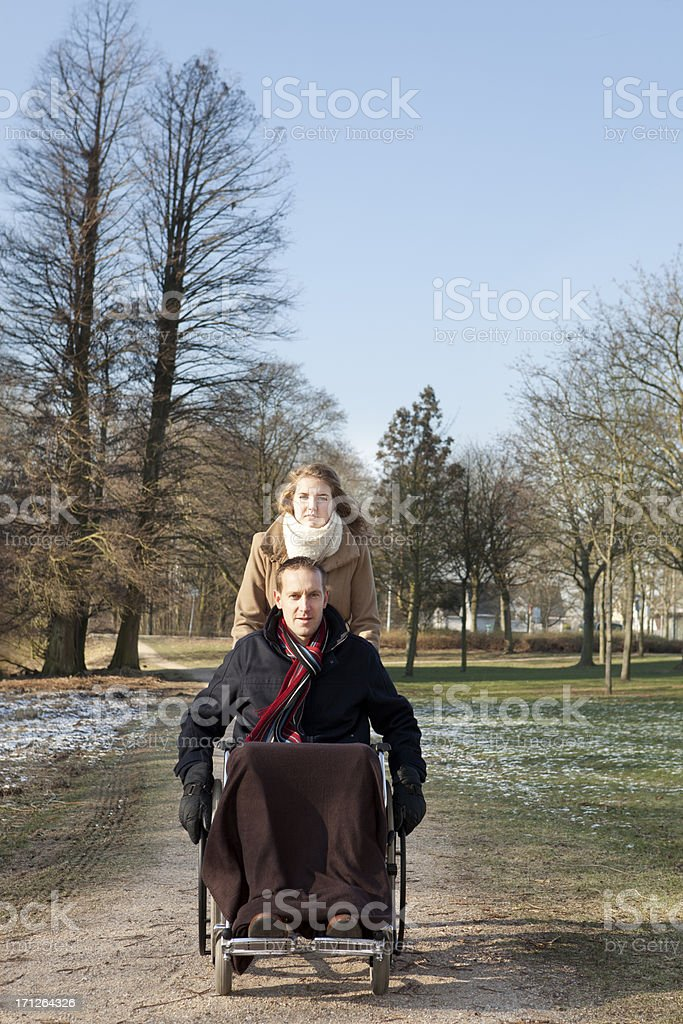 Man in wheelchair And Woman At Park stock photo