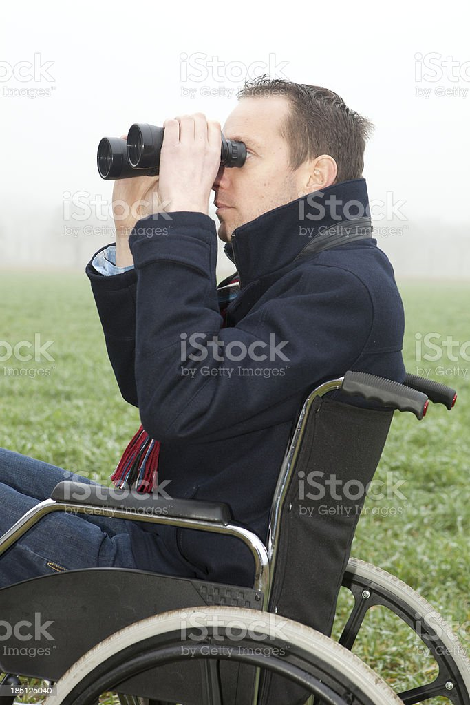 Man in wheelchair looking at view. stock photo