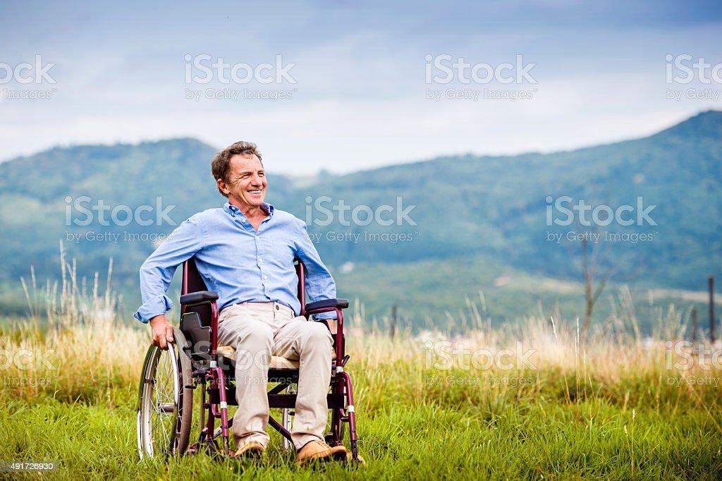 Man in wheelchair stock photo