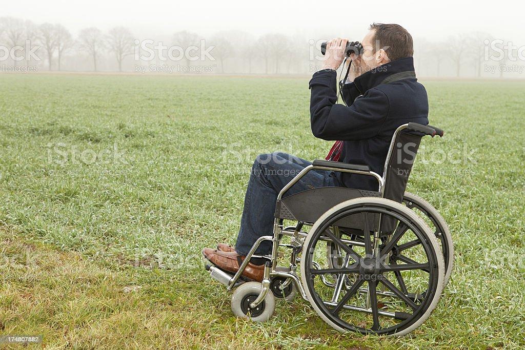 Man in wheelchair spotting birds royalty-free stock photo