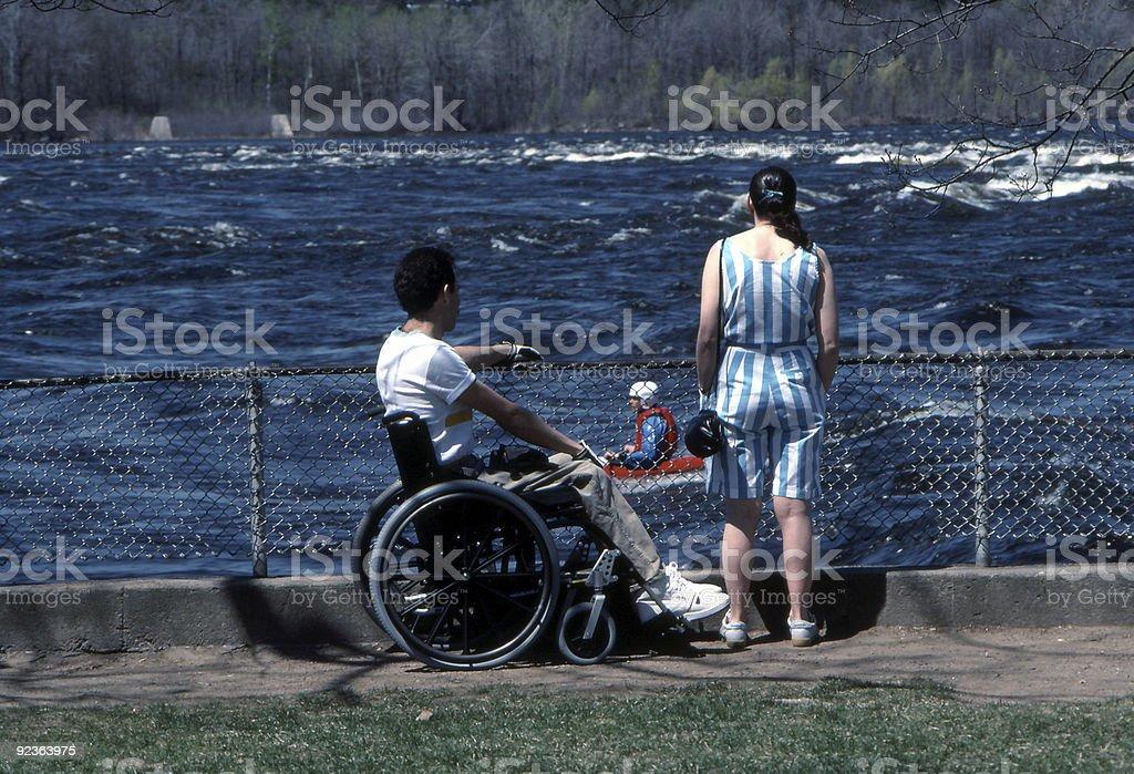 Man in Wheelchair Watching Kayaker royalty-free stock photo