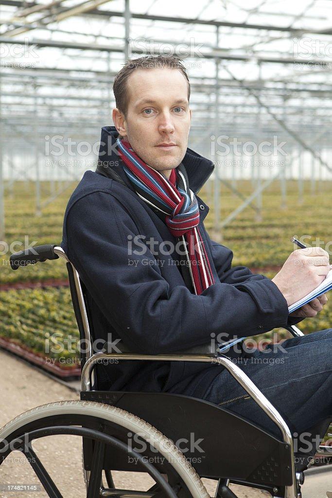 Man in wheelchair working stock photo