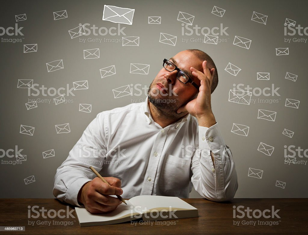 Man in white and letters stock photo